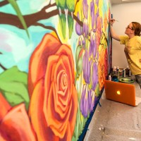 Artist painting mural for Snoezelen Therapy room at Parkview at Whealtland Village.