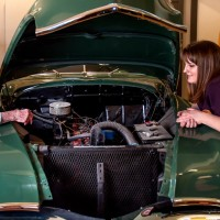 Checking out the engine of the antique car at Parkview Memory Care at Wheatland Village.